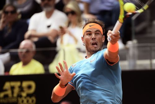 Rafael Nadal powers past Novak Djokovic in the Italian Open final, earning a career first landmark over his long time rival