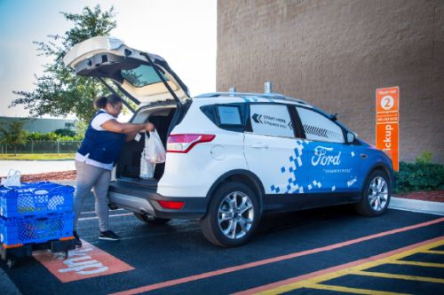 Ford partners with Postmates and Walmart for autonomous grocery delivery in Miami area