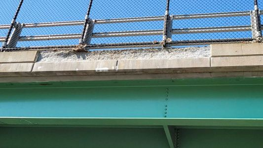 Debris from overpass falls onto Mass Pike; multiple lanes closed, police say