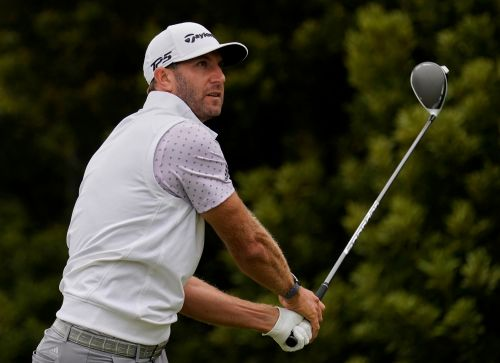 Golf-Complete game gives Johnson third round lead at PGA Championship