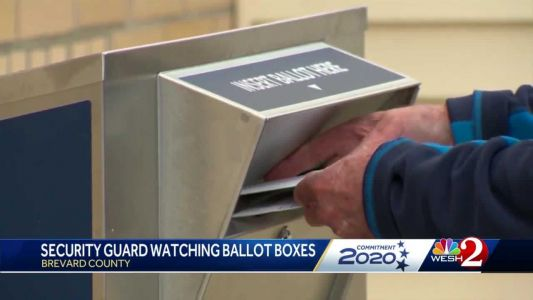 Guards watch over ballot drop off boxes at Brevard supervisor of elections offices