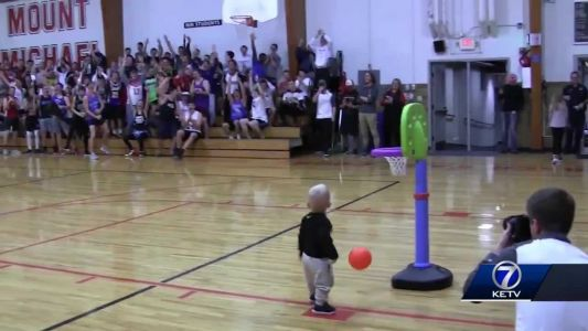Toddler thrills crowd at halftime of high school basketball game