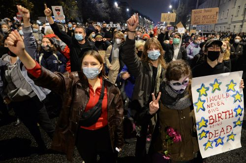 Women in Poland gather at churches to protest new restrictive abortion law