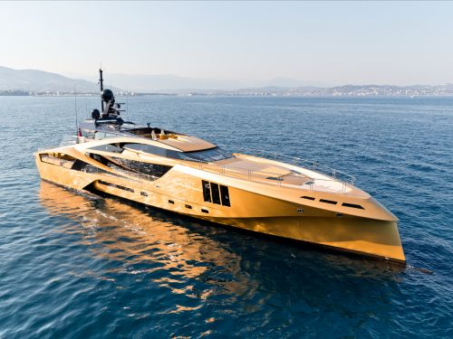 The world's first all-carbon superyacht is on sale for over $30 million - take a peek inside the flashy gold vessel