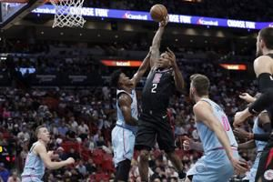 Leonard's 1st triple-double sends Clippers past Heat 122-117