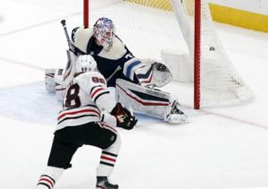 Patrick Kane scores his 398th goal, and Alex DeBrincat's shootout winner gives the Chicago Blackhawks a 6-5 victory over the Columbus Blue Jackets
