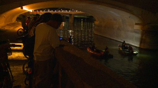 Rescue crews search Des Moines River after reports of man jumping in