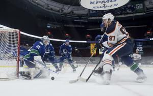 Draisaitl scores twice as Oilers beat Canucks 4-1